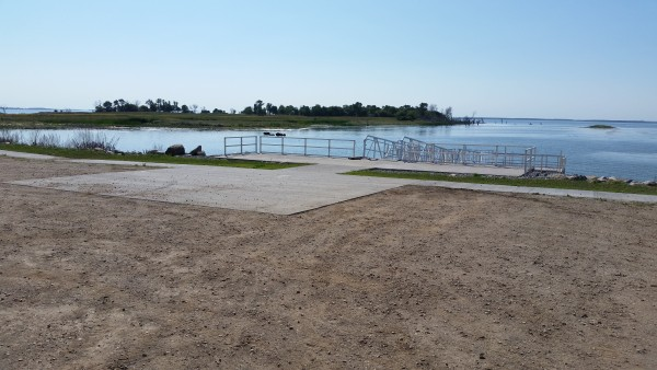 View looking over paved parking area to pier.