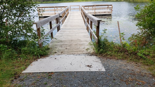 Looking across the parking area used to access both the boat landing and trail leading to fishing pier.