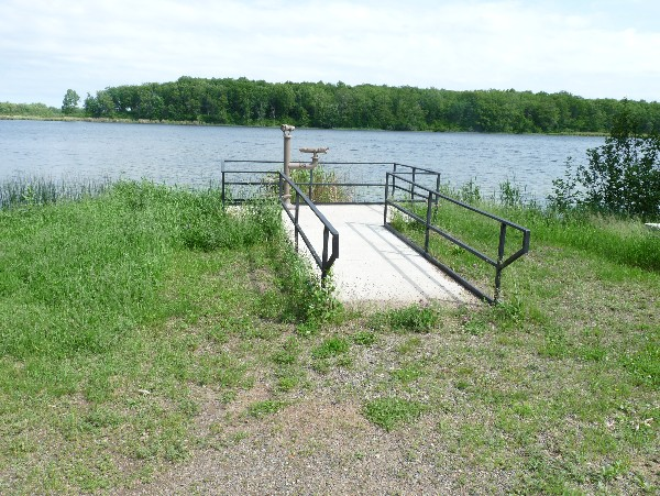 Mandy Lake fishing pier shown jetting out onto lake.