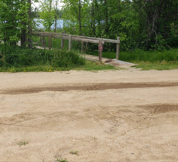 Picture showing the gravel access route to the wooden pier.